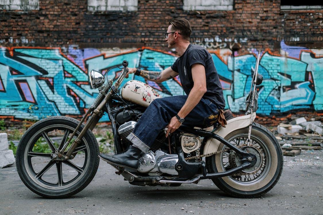 Man in Black T-shirt Riding on Motorcycle