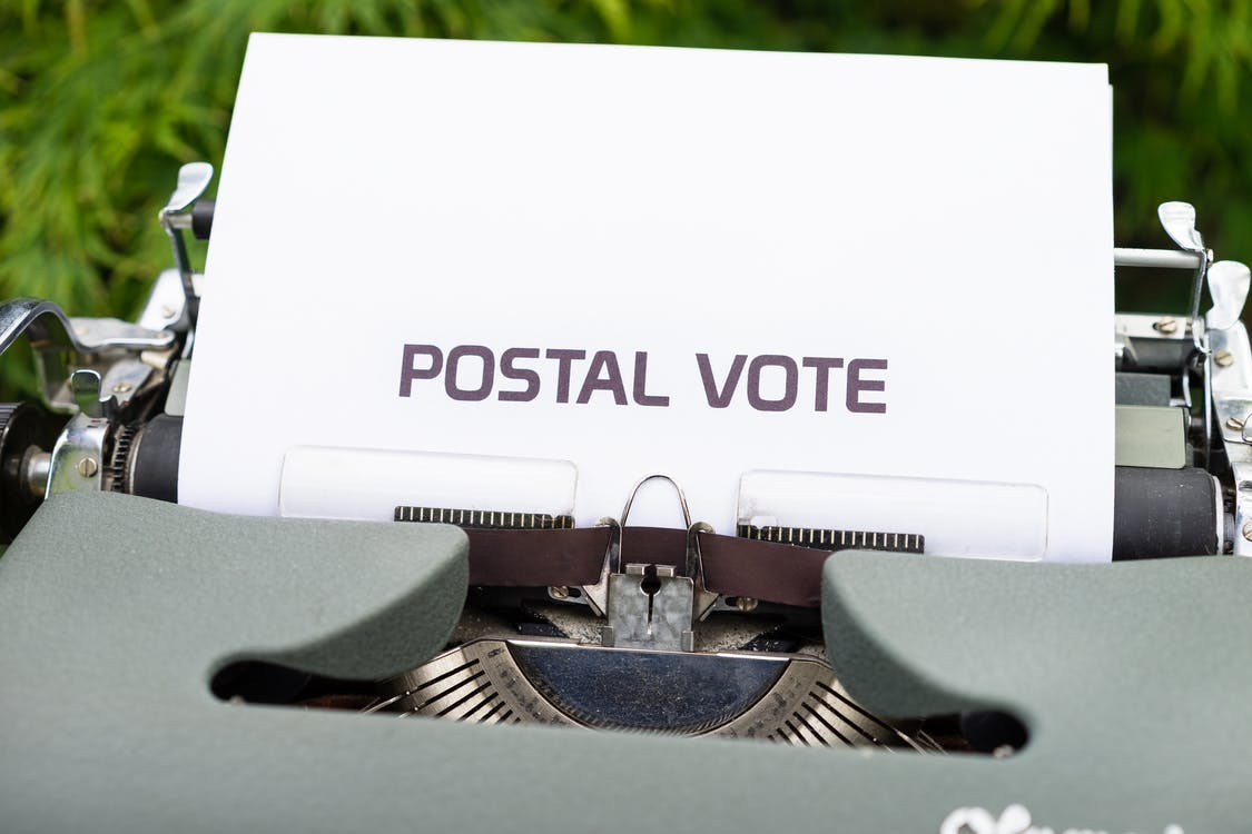 Paper With the Words Postal Vote in a Typewriter