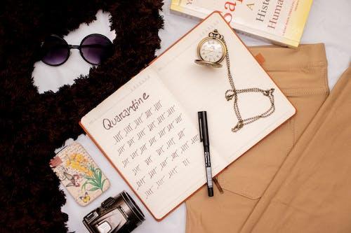Black Pen on White Printer Paper Beside Black Framed Eyeglasses