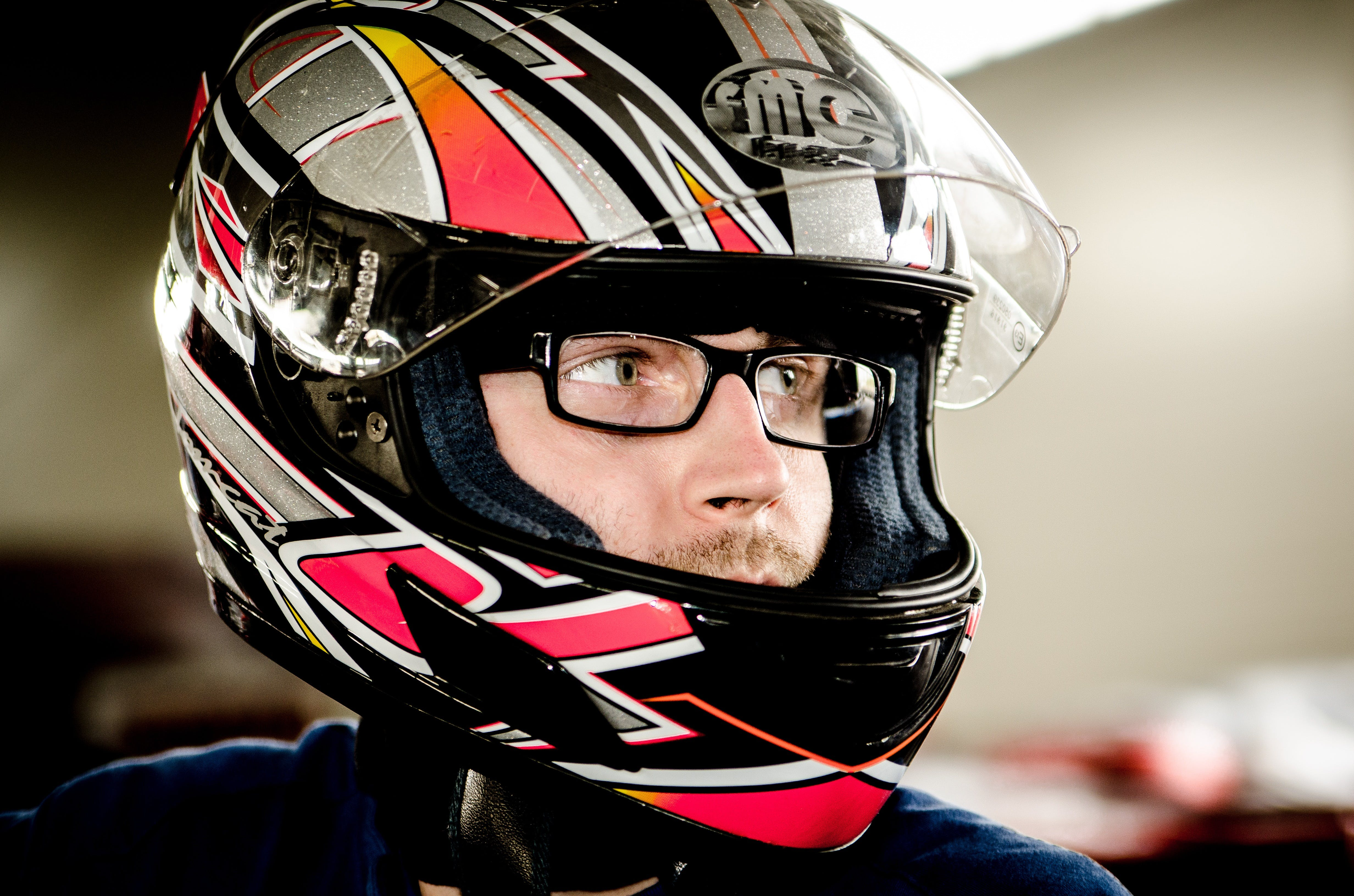 Man Wearing Gray, Red, and Black Full-face Helmet