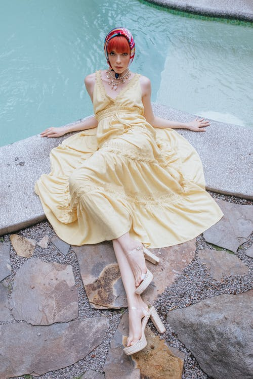 Fashionable woman lying gracefully on poolside