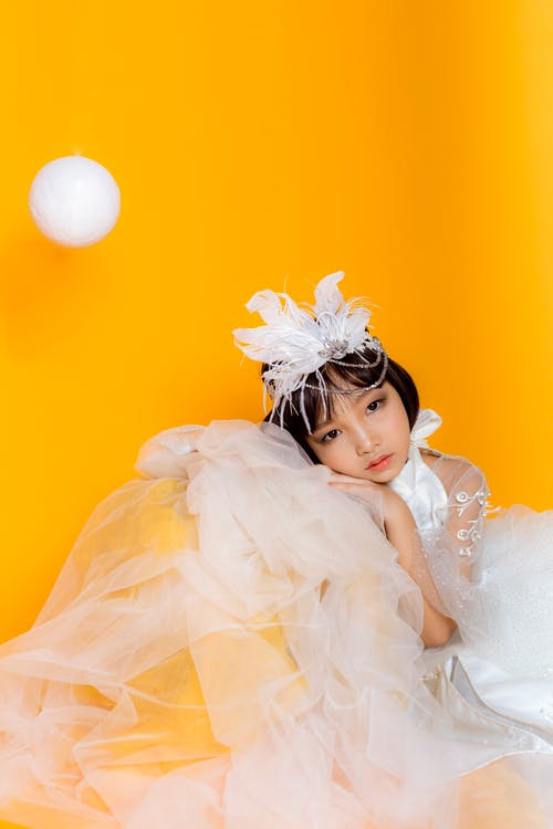 Tender girl in costume on yellow background
