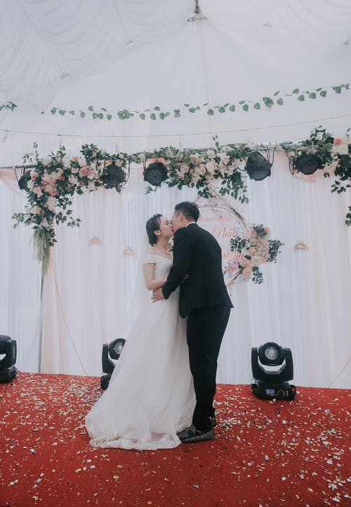 Bride and groom kissing on wedding ceremony