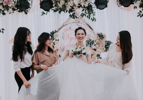Happy bride with girlfriends during wedding