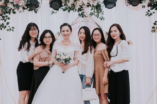 Happy bride with girlfriends on wedding