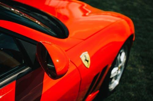 Red Ferrari Car on Gray Asphalt Road