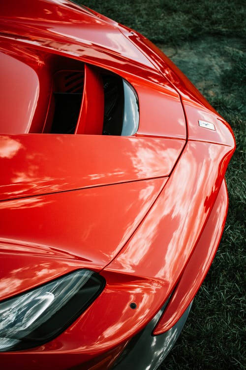 Red Car on Green Grass Field