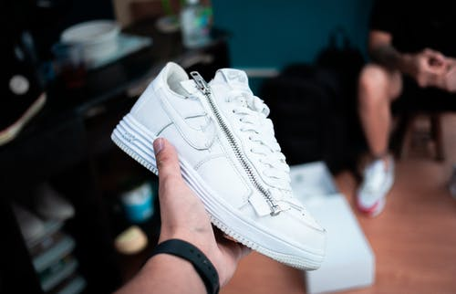 Person Holding White Nike Air Max