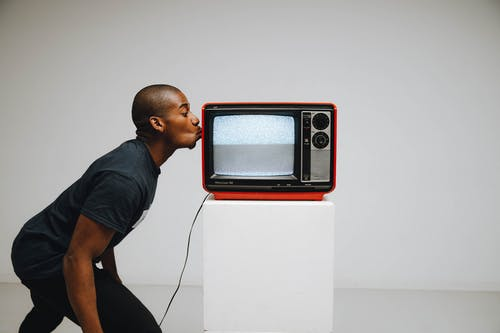 Photo Of A Man Kissing A Television