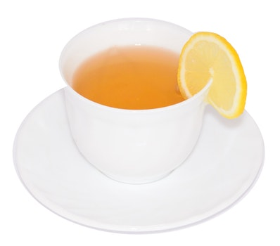 Sliced Lemon on White Ceramic Cup With Tea