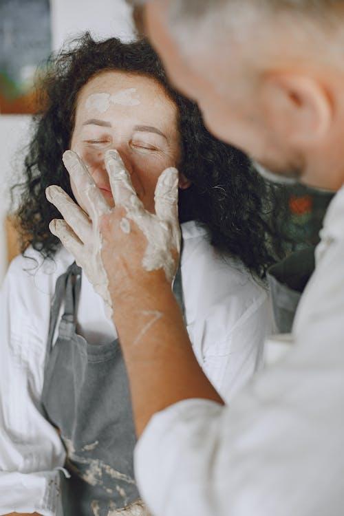 Man Touching a Woman's Face