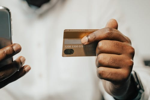 Person Holding Brown Magnetic Card