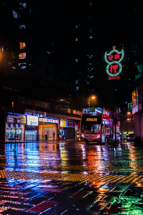 Red Bus on Road during Night Time