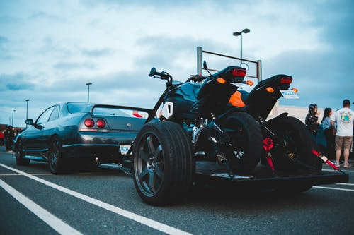 Car towing trailer with motorbikes