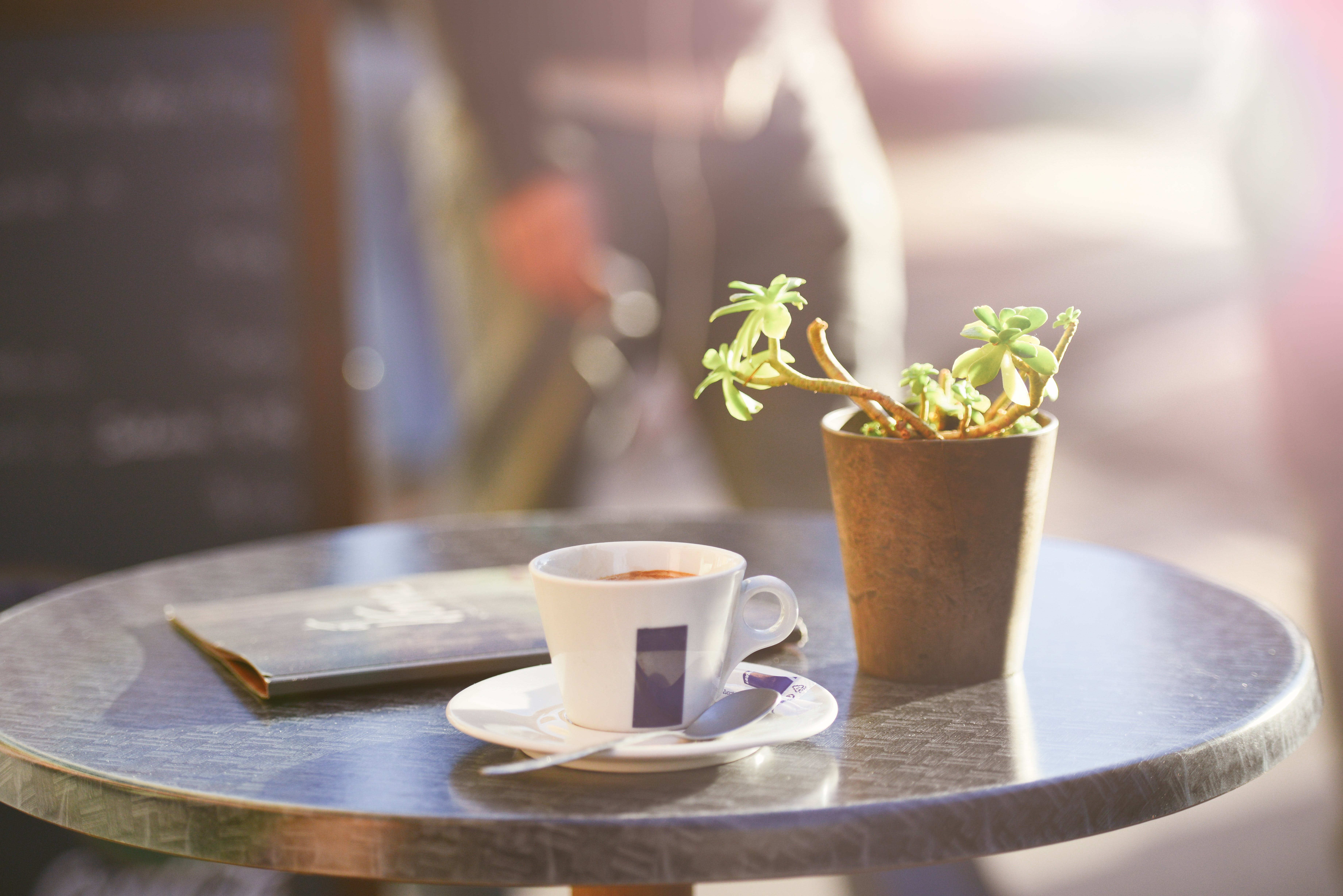 A coffee table in the sun - get out of the house to make friends in a new city.