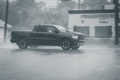 Car driving in rainy weather