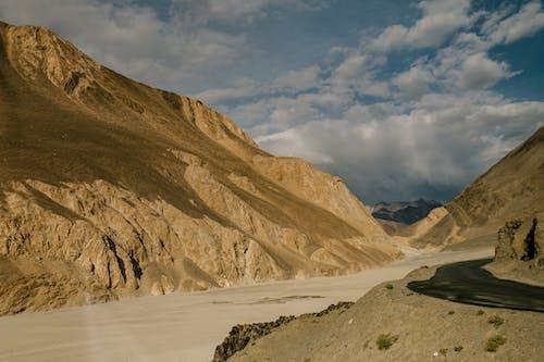 Rural road through mountainous terrain