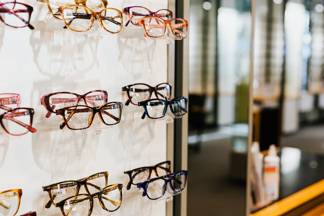 Brown Framed Eyeglasses on White and Brown Table