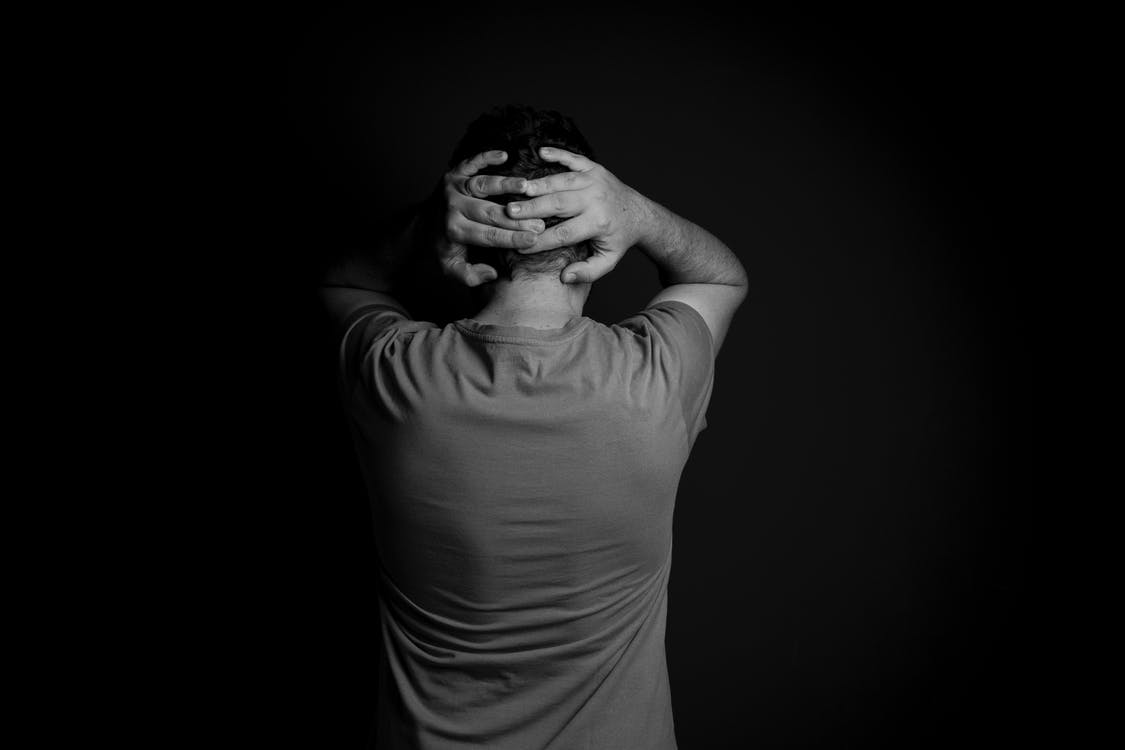 Grayscale Photo of Man in Crew Neck T-shirt