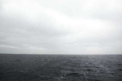 Body of Water Under White Sky