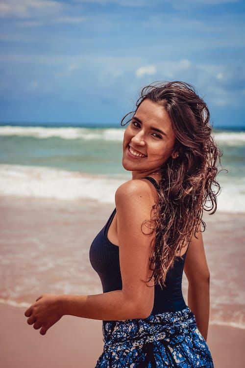Happy woman on tropical beach