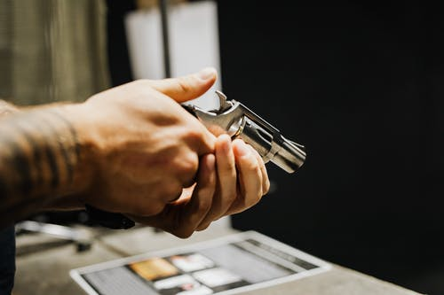 Person Holding Silver and Black Toy Gun