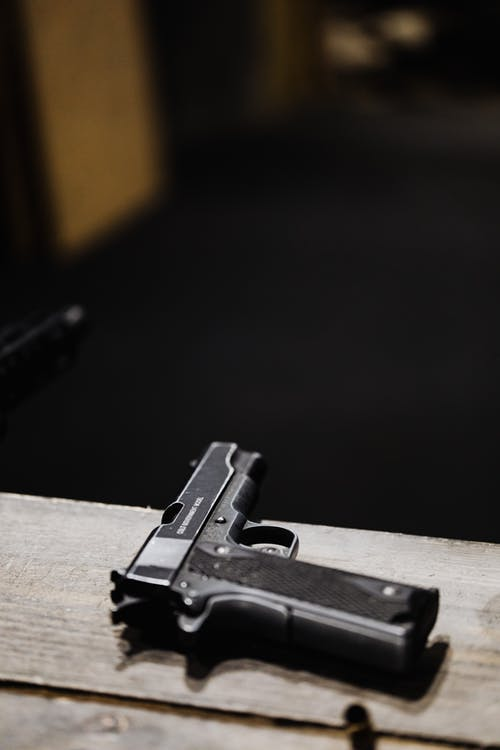 Black Semi Automatic Pistol on Brown Wooden Table