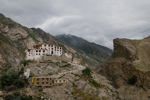 Picturesque mountainous valley with ancient Buddhist monastery on cloudy day