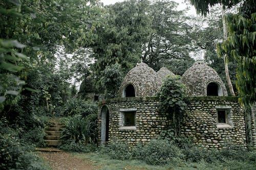Old stone Buddhist meditation house in green garden