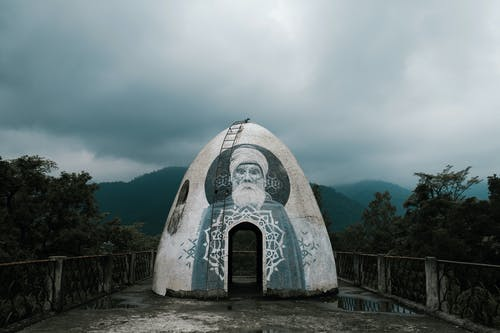 Traditional domed meditation cave against misty sky in mountainous valley