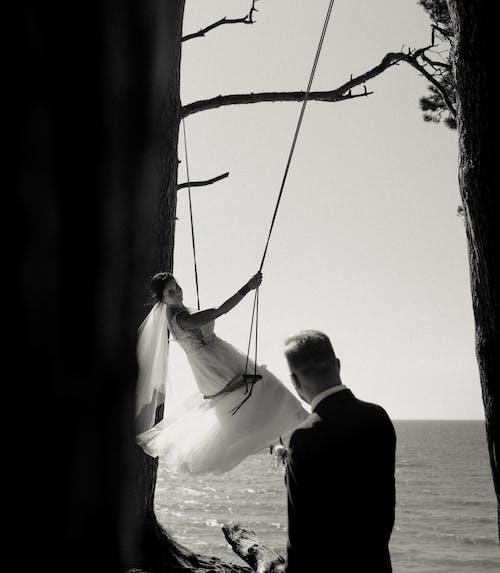 Groom Watching Bride in Swing