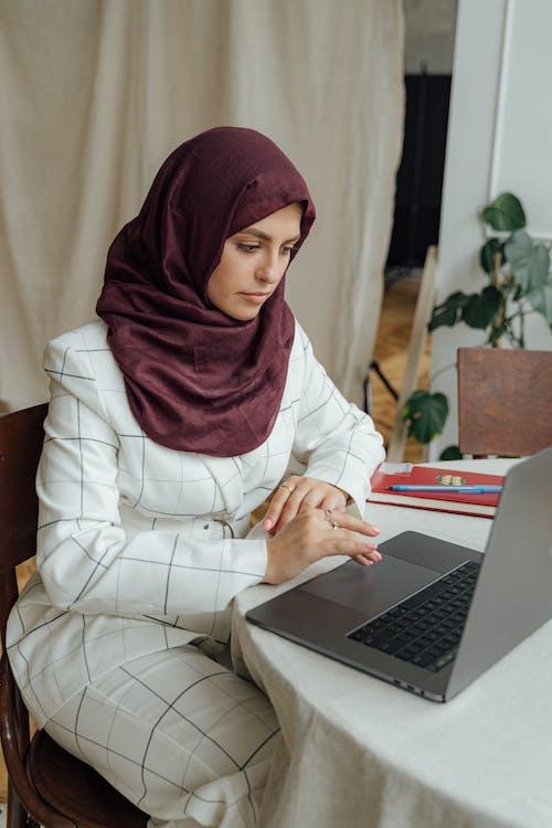 Muslim Woman Using Macbook