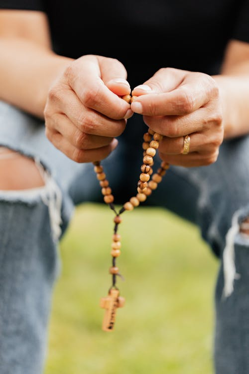 Close-Up Shot of a Person Holding a Rosary