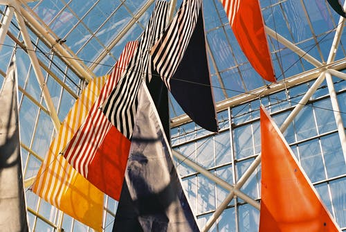 Waving flags hanging on thin cord