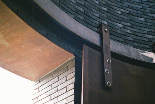 Metal gate rail on building