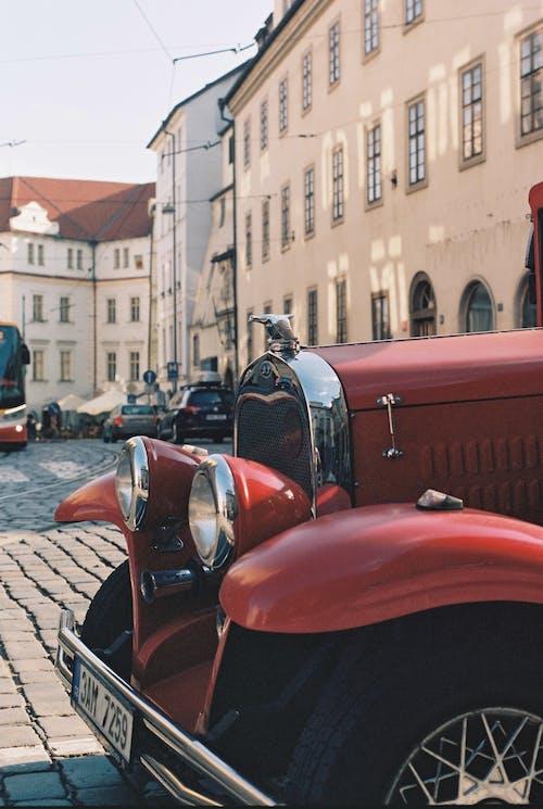 Hood of retro car on street