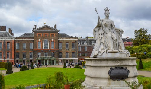 Exterior of Kensington Palace with statue of Queen Victoria