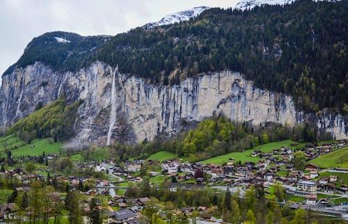 Mountainous terrain with town and lush vegetation