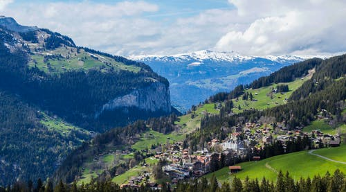 Picturesque alpine village on green mountain slope
