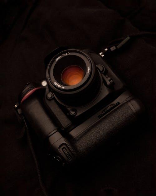 Black Dslr Camera on Black Textile