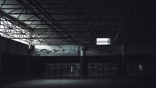 Grayscale Photo of an Abandoned Building