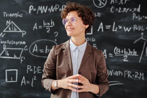 Woman in Brown Blazer Wearing Sunglasses
