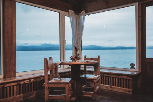 Wooden lounge overlooking calm sea