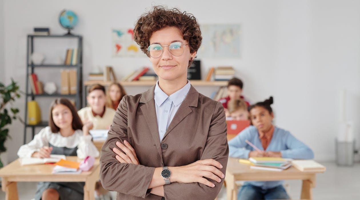 Woman in Brown Blazer Wearing Eyeglasses