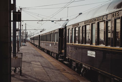 Old fashioned train parked on railroad station