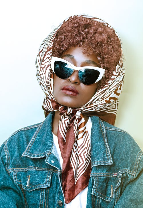 Stylish black woman in trendy sunglasses and headscarf
