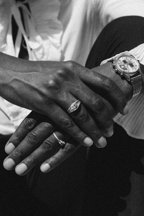 Black man with rings and wristwatch