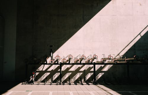 Bicycle parking near concrete wall