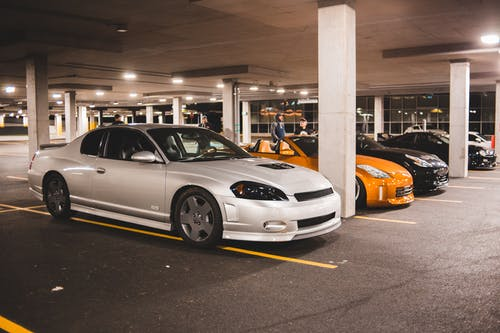 Sport car on illuminated parking lot