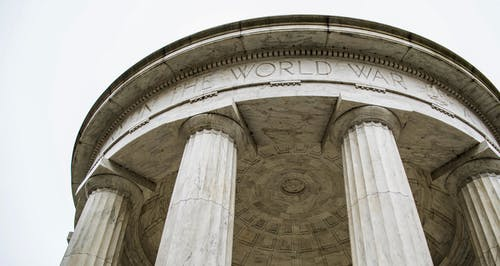 World War I domed memorial with columns against overcast sky